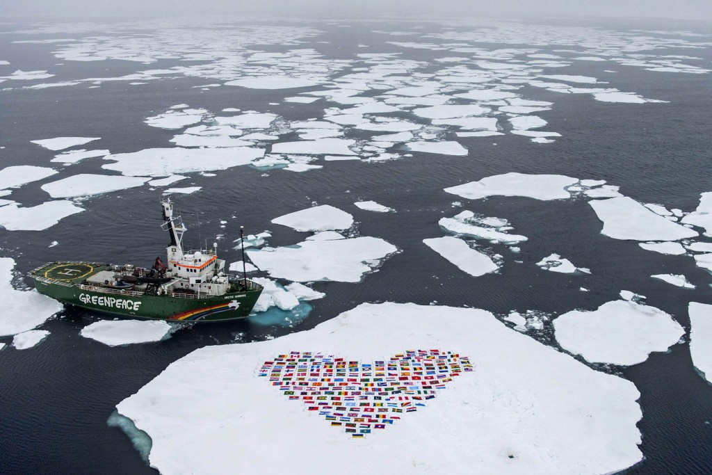 "The crew of the Greenpeace ship My Arctic Sunrise construct a heart with the flags of the 193 country members of the United Nations on an ice floe north of the Arctic Circle on September 14, 2012. The 'heart' of flags is suspended by wires a few centimetres from the ice surface and symbolises an   emotional appeal for united global action to protect the Arctic'. Greenpeace International is hosting an event in New York on the eve of the UN General Assembly which will present the latest science on changes in the Polar regions and then discuss an appropriate response from the international community.  IMAGE AVAILABLE FOR DOWNLOAD BY EXTERNAL MEDIA FOR 14 DAYS AFTER RELEASE - RESTRICTED TO EDITORIAL USE - MANDATORY CREDIT ""AFP PHOTO / GREENPEACE INTERNATIONAL / DANILE BELTRA "" - NO MARKETING NO ADVERTISING CAMPAIGNS - DISTRIBUTED AS A SERVICE TO CLIENTS -- NO ARCHIVE --"