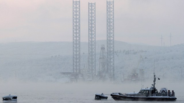 "The ""Kolskaya"" oil drilling rig is pictured in the Kola Bay near Russia's northern seaport of Murmansk in this November 27, 2010 file photo. The oil drilling rig with 67 crew on board capsized and sank off the Russian Far East island of Sakhalin when it ran into a storm while being towed, and 51 of the crew were unaccounted for, Russian news agencies reported on December 18, 2011. REUTERS/Andrei Pronin/Files (RUSSIA - Tags: DISASTER TRANSPORT ENERGY) - RTR2VE4B"