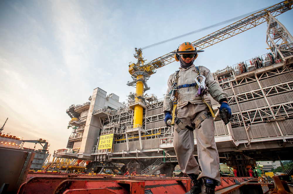 A Samsung employee works on the deck of the Triumph as Statoil's Valemon Topside is loaded for shipment at the Samsung Shipyard on Geoje Island in South Korea on Sunday, June 1, 2014. (Ben Weller/AP/Statoil)