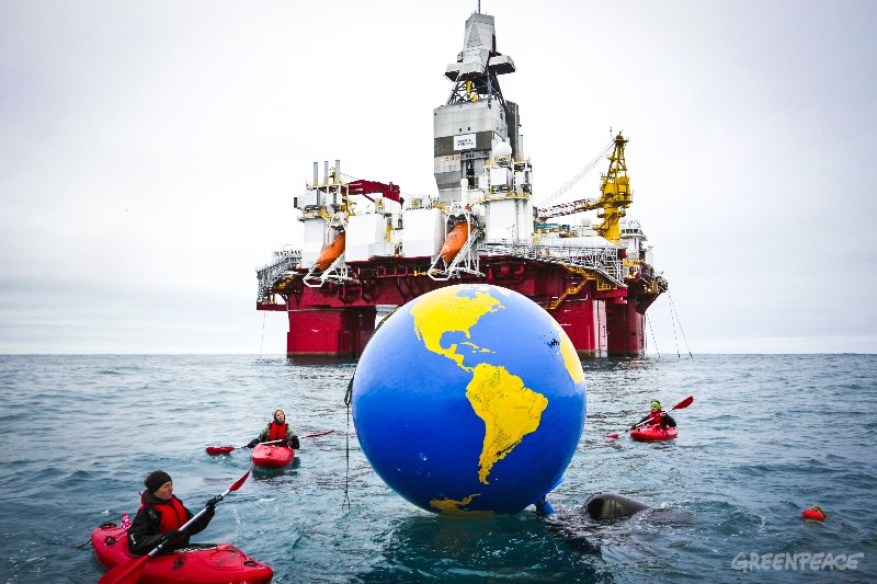 4 people in kayaks have reached Statoil's rig, the Songa Enabler. They are bringing a huge globe with messages from people around the world urging the Norwegian government to end its Arctic oil expansion. The Greenpeace ship Arctic Sunrise is in the Norwegian Arctic to document, expose and challenge the Norwegian government and Statoil's aggressive search for new oil in the Barents Sea. Statoil has just started their drilling operations at the Korpfjell site using the rig called Songa Enabler. The Arctic Sunrise is carrying activists from all over the world, who are ambassadors for the People Versus Arctic Oil movement. Greenpeace Nordic and its co-plaintiff, Natur og Ungdom (Nature and Youth), will face the government in Court in Oslo in November, where the new drilling will be subject to a historic climate lawsuit. They argue that granting licenses to open a new oil frontier breaches the Norwegian Constitutional right to a healthy and safe environment for current and future generations and contravenes the Paris Agreement.