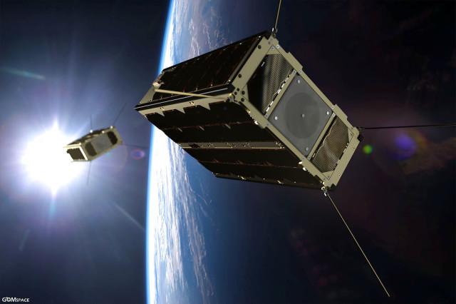 """December 21, 2017 - Paris, France - ESA's next miniature satellite will be its first able to change orbit. Thanks to a compact thruster resembling a butane cigarette lighter, the cereal box-sized satellite will fly around its near-twin to test their radio communications. Ready to be launched with its counterpart from China on 2 February, GomX-4B is built from six standard 10 cm CubeSat units. En danskudviklet minisatellit - en såkaldt cubesat - bliver sendt ud i rummet fredag morgen klokken 8.51 dansk tid. Den skal udføre overvågningsopgaver i Arktis for Forsvaret. Det er første gang, Forsvaret sender sin egen satellit ud i rummet. Satellitten, der hedder Ulloriaq, bliver sendt afsted fra Kina, hvis vejret tillader. Den er om bord på en kinesisk """"Long March""""-løfteraket. Det skriver Ritzau, fredag den 2. februar 2018.. (Foto: ESA/ZUMA Wire/Scanpix 2018)"""