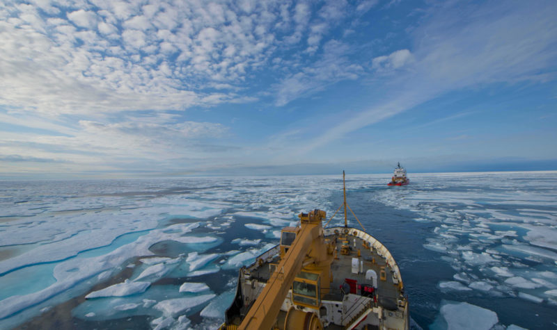 The crew of U.S. Coast Guard Cutter Maple follows the crew of Canadian Coast Guard Icebreaker Terry Fox through the icy waters of Franklin Strait, in Nunavut Canada, August 11, 2017. The Canadian Coast Guard assisted Maple's crew by breaking and helping navigate through ice during several days of Maple's 2017 Northwest Passage transit. U.S. Coast Guard photo by Petty Officer 2nd Class Nate Littlejohn.