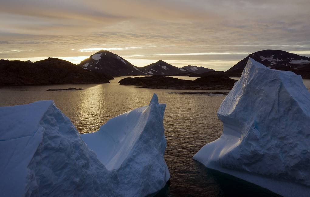 An aerial view of large Icebergs floating as the sun rises near Kulusuk, Greenland, early Friday, Aug. 16, 2019. Greenland has been melting faster in the last decade and this summer, it has seen two of the biggest melts on record since 2012. (AP Photo/Felipe Dana)