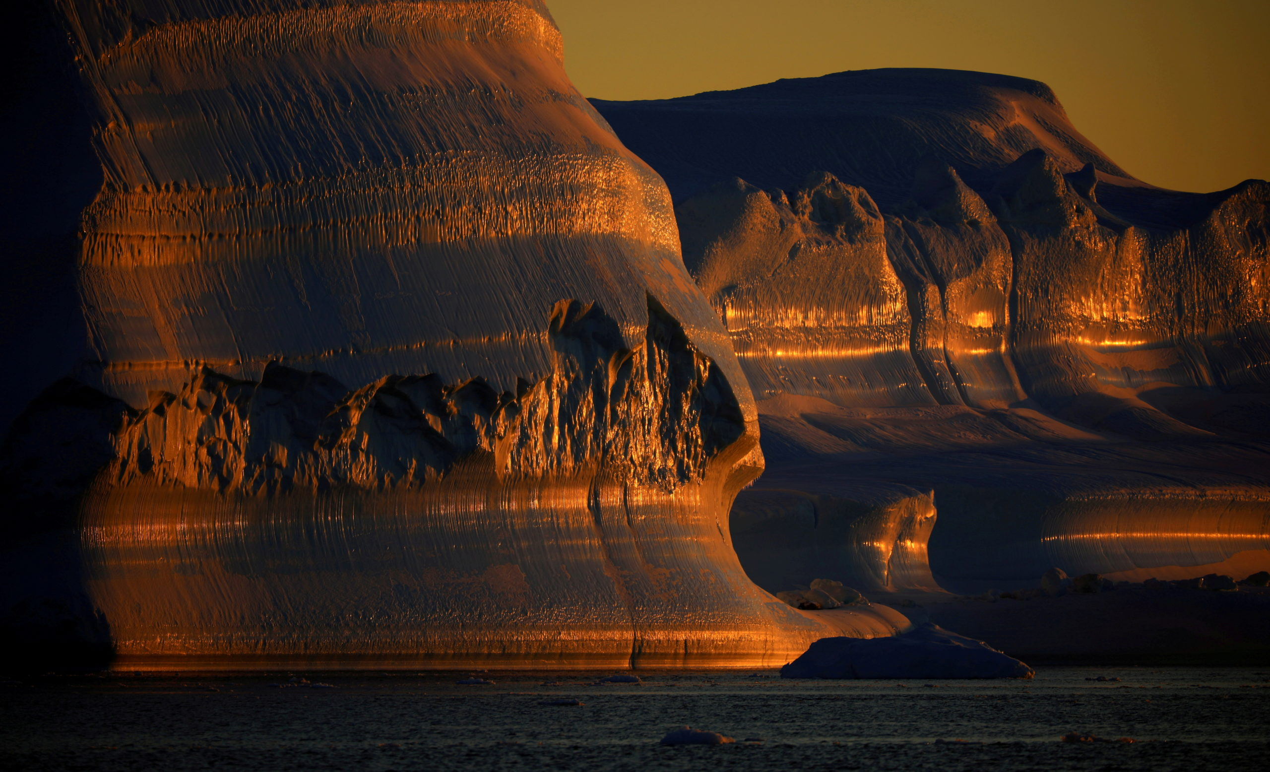 FILE PHOTO: Icebergs are seen at the at the mouth of the Jakobshavns ice fjord during sunset near Ilulissat, Greenland, September 16, 2021. REUTERS/Hannibal Hanschke/File Photo
